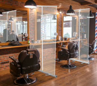 Clear roll up banner screen in hairdressers salon